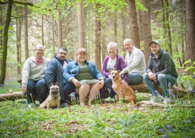 whole family in photoshoot in the bluebells