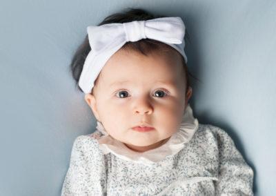 baby girl in blue