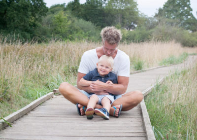 dad and son cuddling in outdoor family session