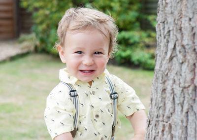 boy smiling in his garden