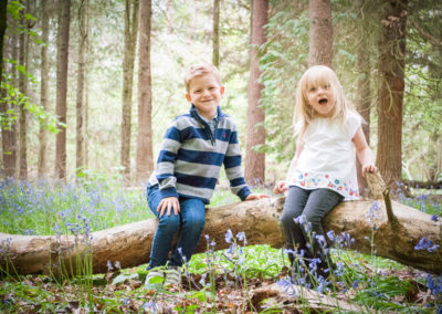 brother and sister in the bluebells