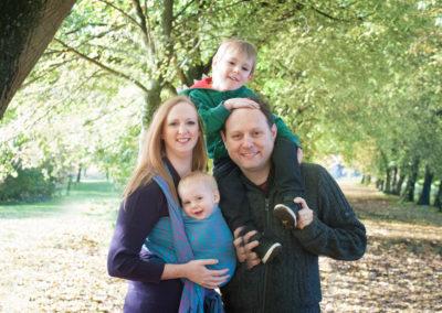 family of 4 in farnham park smiling