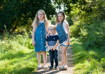 brother and big sisters in photoshoot farnham