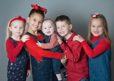 cousins smiling in Runfold photoshoot