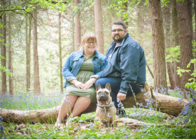 couple and dog in bluebells in guildford