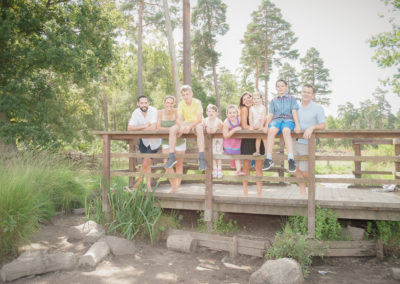 outdoor whole family photo session altogether on bridge