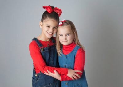 Cousins smiling in a studio photoshoot in farnham