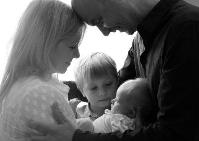 family with their newborn baby girl